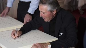 Gary Player signs the Laureus Opus
